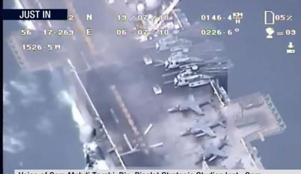 الحرس الثوري الإيراني ينشر صوراً التقطتها طائرة مسيرة لمدمرة امريكية