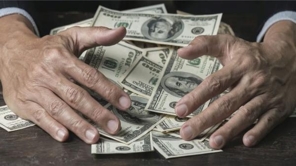 اختراع آلة لغسل النقود تقضي على خطر انتقال كورونا في 3 ثوانٍ