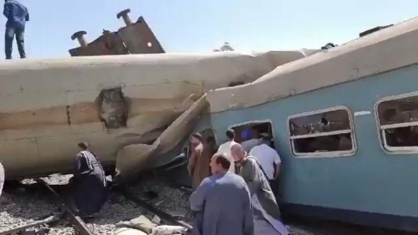 بالفيديو: وفاة 32 مواطناً وإصابة 165 آخرين في حادث تصادم قطاري سوهاج بمصر